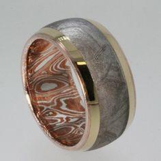 Meteorite Ring inlaid on Mokume Gane with 18K Gold Pinstripes great Wedding Band. $1,499.00, via Etsy.