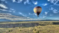 Pueblo Balloons - Panoramic views of the Rio Grande Gorge and a birds-eye-view of Taos during your balloon ride with Pueblo Balloons! - Call 1-575-751-9877