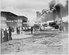 Picture of the Apron at Pearl Harbor-Cleaning up the apron at Ford Island, Naval Air Station at Pearl Harbor, after the Japanese attack on Dec. 7, 1941. (12/07/1941)