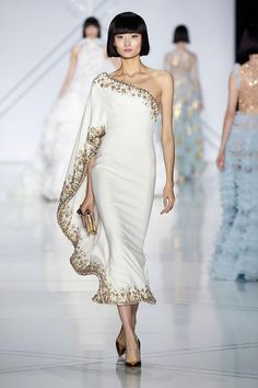 White silk crêpe one-shoulder kaftan dress, encrusted with gold crystal, pearl and glass bead borders.
