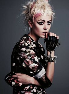 Grunge. Punk. Fashion. Peroxide Blonde. Baby bangs. Pink hair. Pastel Pink. Floral. Spikes. Gloves. Black gloves. Leather gloves. Gray background. Grey.
