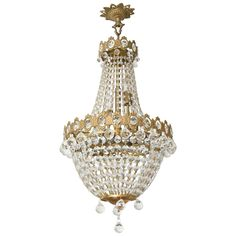 Hollywood Regency, Louis XVI Style Chandelier in Antique Brass and Crystals | From a unique collection of antique and modern chandeliers and pendants at https://www.1stdibs.com/furniture/lighting/chandeliers-pendant-lights/
