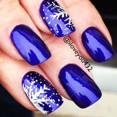 A beautiful metallic royal blue nail polish / nail art with snowflakes is perfect for the beginning of December