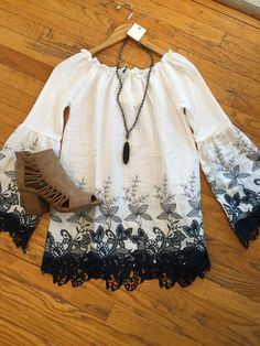 Love this new white and navy embroidered tunic!