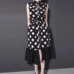 "HPPolka dot shirt dress w ruffled skirt HP 6/1 New Listing Romantic yet modern designer piece. Two types of premium chiffon material, polka dot upper shirt dress, sleeveless, adjustable waist w a belt, bottom is ruffled black chiffon skirt. Button down, two side pockets. Very stylish and feminine. One size, fits S/M, flat measurements: length 40.5"", shoulder 13.4"", bust 37.5"", waist 25-37.5"", hip 39.5"". ❤️Price is firm❤️ I discount bundles Bella's Premium Boutique Dresses"