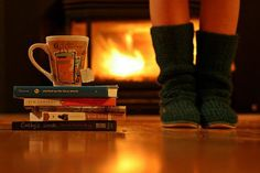 cozy fire & slippers, a couple good books & a warm cup of tea. a relaxing night at home