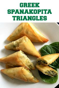 Greek Spanakopita Triangles or feta and spinach pies a fantastic appetizer or healthy snack and can be enjoyed either warm or cold Learn how to fold the phyllo dough to p. Greek Spinach Pie, Spinach And Feta, Greek Appetizers, Appetizer Recipes, Yummy Appetizers, Appetizer Buffet, Vegetarian Recipes, Cooking Recipes, Healthy Recipes