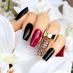 Red, black, gold bow leopard nails ✿⊱╮