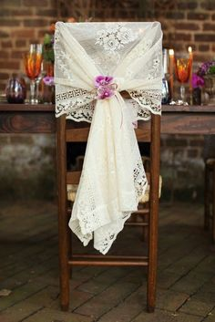 Heavy Lace: For a rustic wedding with a dose of pretty.(Grandma's tablecloth?) Source: Kristy Dickerson Photography #lace #chairdecor #rusticwedding