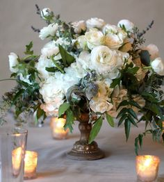 Romantic Wedding centerpieces for Fall and Winter; via Stems Floral Design and Productions