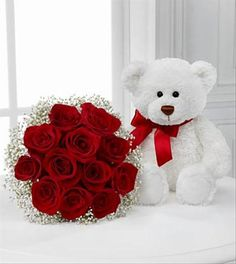 The Meant to Be Rose Bouquet is a wonderful expression of love and affection. Brilliant red roses form a gorgeous bouquet accented around the outside with bright white baby's breath. Accompanied by a sweet white plush bear with a red ribbon around his neck, this gift is the perfect way to show your love.