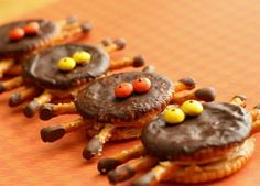 Ritz Cracker Spider treats - try with just the crackers and cheese whiz and pretzels and some healthier eyes for school
