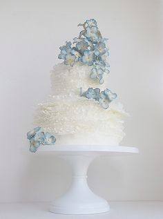 Maggie Austin Cake.  Gorgeous white ruffles with a shade of blue in the flowers that is just lovely.   ᘡղᘠ