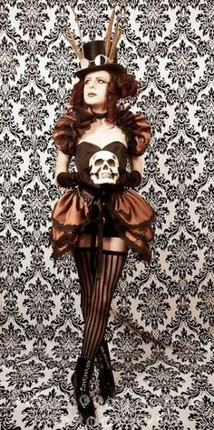 Steampunk Diva skirt and shrug set by GothicBurlesque on Etsy. I absolutely adore the skull! And ladies, I've mentioned where you can find these dresses as much as I'm able to. It might interest you to know that all of these dresses are shown in plus sizes. So let your beauty shine in all of it's shapes and sizes. Enjoy!  #plussize #steampunk #skull #dress #ladiesfashion
