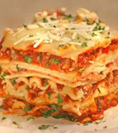 World's Best Lasagna 1 lb sweet italian sausage 3/4 lb lean ground beef 1/2 cup minced onion 2 cloves crushed garlic 28 ozs crushed tomatoes 12 ozs tomato paste 13 ozs tomato sauce (canned) 1/2 cup water 2 tbsps white sugar 1 1/2 tsps basil leaves (dried) 1/2 tsp fennel seeds 1 tsp italian seasoning 1 tbsp salt 1/4 tsp black pepper (ground) 4 tbsps fresh parsley (chopped) 12 lasagna noodles 16 ozs ricotta cheese 1 egg 1/2 tsp salt 3/4 lb mozzarella cheese (sliced) 3/4 cup grated parmesan…