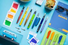 Love this assortment of light and bright pens, inks and notebook!