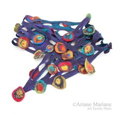 Hey, I found this really awesome Etsy listing at https://www.etsy.com/listing/206080026/nuno-felt-flower-scarf-purple-emerald