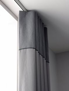 Ripplefold Draperies on a ceiling mounted zip rod with contrast heading