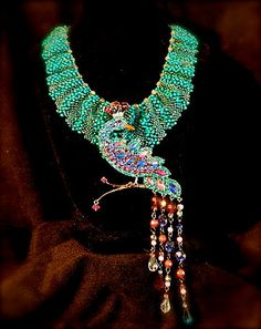This elegant collar necklace can be worn without the peacock for a more casual look, but the old Avon peacock adds a touch of glamor.