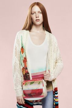 Brightly colored shoulder bag with a floral print