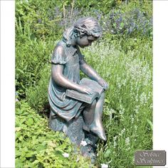 Daphne reading girl statue