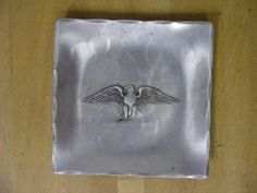 Content/listingImages/20130921/cb9e1ed3-b20d-4a23-9669-3dc1ee83224d_fullsize.jpg  Vintage hand-made Wendell August pewter dish Eagle decoration  4x4.  Please visit www.bidsbyzip.com to bid and win this item! Bidding starts at .99!!!