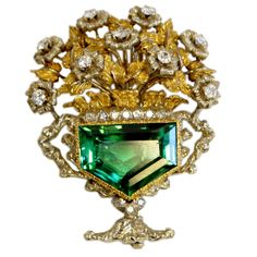 Buccelati Tourmaline and Diamond Flower Pot Brooch, Italy, 20th century  Rare two tone gold and diamond floral spray centering a Pentagon shape green tourmaline.