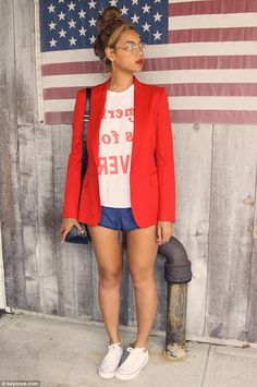 Patriotic style:The star wore an American themed look featuring a pair of very short blue shorts, a white T-shirt with red lettering and a red blazer