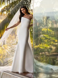Less is more on this impeccably cut mermaid gown, tailored in glossy Mikado silk. The asymmetrical pointed neckline accentuates feminine shoulders and adds an on-trend touch for the modern bride. Pronovias Wedding Dress, Stunning Wedding Dresses, Wedding Dress Styles, Designer Wedding Dresses, Bridal Dresses, Wedding Gowns, Mermaid Gown, Mermaid Dresses, Fit N Flare Dress