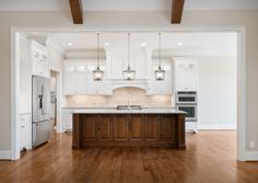 GORGEOUS white Southern style kitchen with a dark wood center island. LOVE LOVE LOVE the brick backsplash and iron inspired light fixtures. Walnut Kitchen Cabinets, Wood Kitchen Island, Kitchen Redo, Kitchen Styling, Kitchen Remodel, Kitchen Center Island, Dark Wood Cabinets, White Cupboards, Big Kitchen
