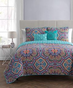 Rich hues and a pop of pattern add intrigue to your bedroom with this colorful quilt set. Includes one quilt, one sham and two decorative pillows100% polyesterMachine wash; tumble dryImported