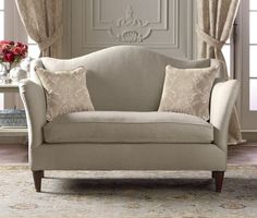 I must have this.    Camelback Loveseat by Pierre Deux traditional love seats