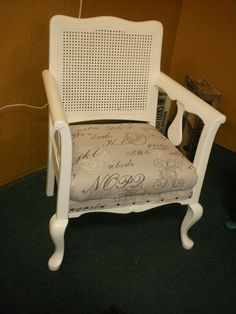 Old cane-back chair updated with Navajo White paint and current fabric.