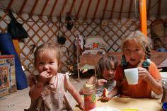 Mongolian children in the yurt by Alex Yule