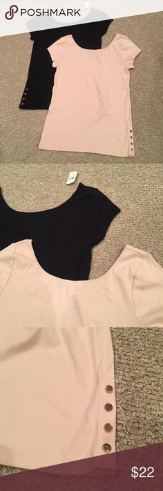 NWT Ann Taylor Lot of 2 Scoop Neck Tees Purchased on Posh but they are a little too small for me. One is Navy and the other a pale pink/ nude color. Cute Button detail on bottom. Ann Taylor Tops Tees - Short Sleeve