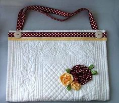 Cute (and easy) little placemat purse--pretty placemat, ribbon, button and a little fabri-tac glue.