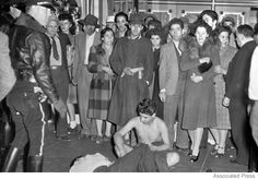 In 1943 in Los Angeles, roving gangs of U. servicemen attacked and stripped Mexican Americans they spotted wearing Zoot suits. The two young men on the ground were victims; many were arrested and jailed. The Zoot Suit Riots were a series of racial.
