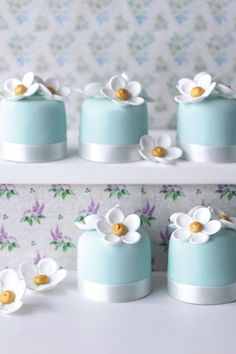 Light blue petits fours with white flowers and ribbon