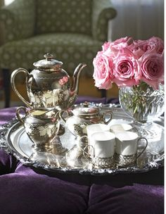 I love antique tea sets used as decorative pieces in rooms like the library or a parlor room!
