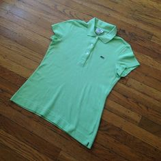 Lacoste polo Lacoste polo that was worn a handful of times. Slight stain as pictured otherwise in great condition. Add a pop of color to your closet with this cute polo! Price is negotiable. Please make offers using the make an offer feature. Happy Poshing  Lacoste Tops