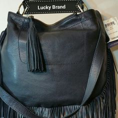 "Lucky Brand Rickey leather bag Details:- Single top handle - Detachable, adjustable shoulder strap - Open top magnetic closure - Exterior features fringe detail and top zip pocket with fringe tassel - Interior features wall zip pocket and 2 media pockets - Approx. 12.5"" H x 15.5"" W x 1"" D - Approx. 9"" handle drop, 14-22"" strap drop - Imported  Materials:Leather exterior, cotton lining Lucky Brand  Bags Crossbody Bags"