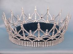 BEAUTY PAGEANT QUEEN RHINESTONE FULL CROWN SILVER A stunning, beautiful, imposing full crown, worthy of a world class beauty queen. he crown has an elegant scroll design with peaks rising to make a st