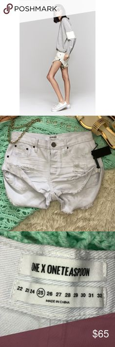 NWT One Teaspoon bandits cut off fringe shorts 25 NWT One Teaspoon bandits cut off fringe shorts in white beauty size 25. Distressed destroyed white denim shorts, 100% cotton. Slouchy fit with button fly. Reasonable offers always accepted. One Teaspoon Shorts Jean Shorts