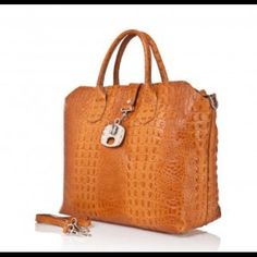 Giancarlo Bassi Leather Croco Satchel NWT Giancarlo Bassi Leather Croco Satchel Made in Italy, Giancarlo Bassi Handbags are innovative, stylish and made out of soft, genuine leather. Classically European and always on-trend, the range provides the perfect way to make style affordable. Features Genuine leather crocodile print Zip and hook closure Interior zipper pocket and for smartphone 49 X 31 X 16 Giancarlo Bassi Bags Satchels