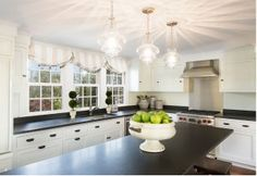 Kitchen window with shades. Casabella Home Furnishings & Interiors.