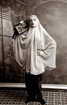 Shadi Ghadirian; Qajar series. reconstructing the atmosphere of a previous era by using old backdrops. models wearing clothes from the turn of the 20th century and are carrying objects, mostly smuggled, into contemporary Iran.