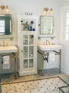 a lot of love goin on here  sinks, cabinet, items inside cabinet, mirrors, flooring  yep a lot of love :-)