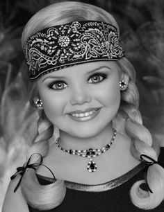 Eden Wood(:  child beauty pageant designer. Looks like a doll, but...apparently not...