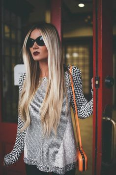 Sombre color. Brown blended to heavy blonde. Long hair.