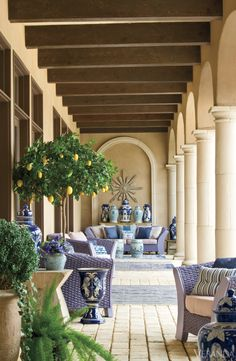 The open-air patio provides extensive room to relax and entertain during the warm Texas summer.  Custom sofa and chairs. Pillows, starburst and stools, Ceylon et Cie. Angular table, Allan Night. Dhurries, Art of Old India.   - Veranda.com